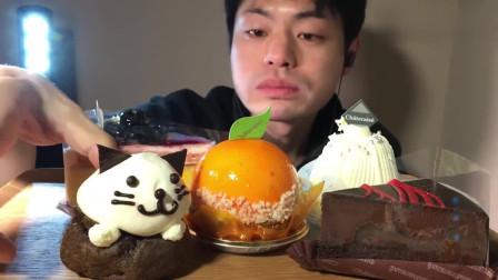 猫咪巧克力泡芙+蓝莓卡仕达芝士蛋糕,小哥大口吃的真馋人