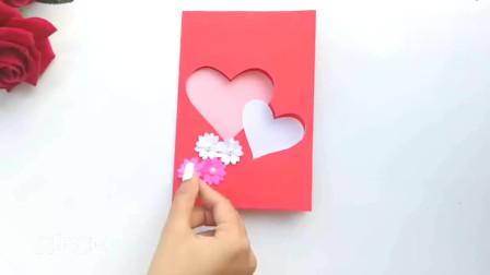 简单漂亮的新年贺卡,封面有两个镂空的爱心,制作方法简单