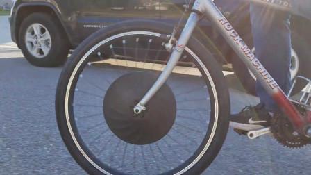 老外发明助力自行车,车轮可化重力为动力,爬起坡来毫不费力