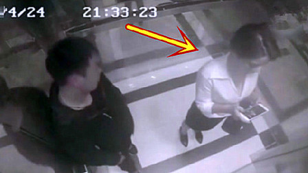 漂亮女白领电梯里玩手机,遭遇咸猪手,两拳一腿撂倒