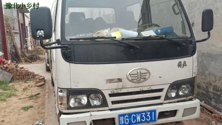 农村小伙花10000多元买了辆二手小货车,大家看看这车值不值?