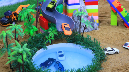 用积木给小汽车们建一个池塘