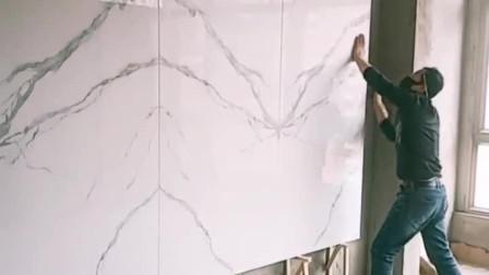 近两米的大号瓷砖做影视墙,这粘贴安装手艺够大胆吧!