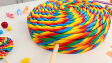 巨大的彩虹棒棒糖蛋糕,看着心情就好,我都是用它哄女朋友的