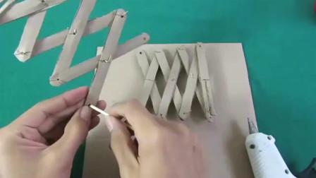 手工牛人用纸板和雪糕棒制作出液压升降机