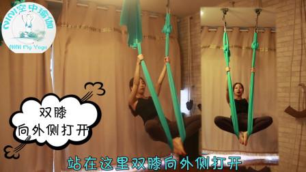 空中瑜伽之倒立,保证人要在吊床中央,脚趾要冲向身体后方