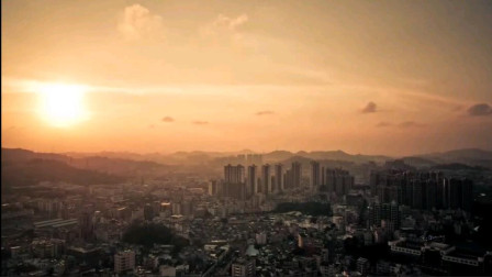 航拍日落下的繁华城市延时夕阳日落