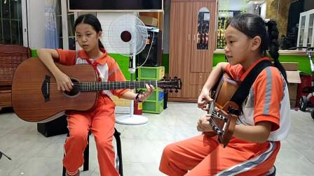 张米乐,朱亿馨同学合作弹唱《兰花草》视频