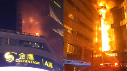 南京金鹰失火烈焰引燃墙体 明火已被完全扑灭