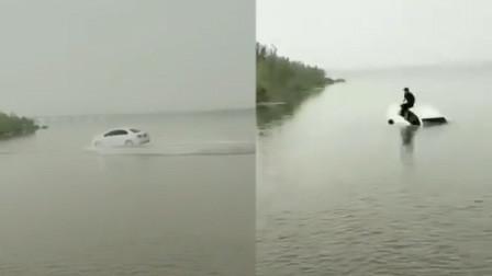 私家车漫水桥上玩漂移 连人带车坠入黄台湖