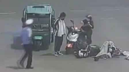 压力太大!高三学生骑车突然晕倒 险被后车碾压