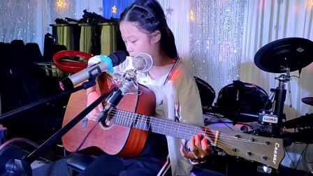 张米乐同学学习舞台表演吉他弹唱《兰花草》