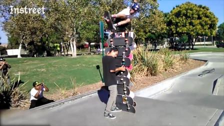 谁能帮我数一下这是多少块滑板?反正是比这个人还要高一头