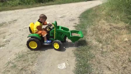 儿童游戏:一辆卡车被困在泥泞中,小男孩骑着拖拉机去救援