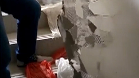 新房验收所见之处一碰就掉 业主:可以手撕整栋楼