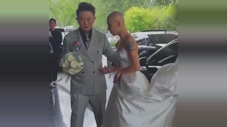 新娘是光头就让人望而生畏,看见纹身的那一刻,这新娘是个狠人