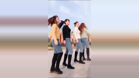 美女广场跳鬼步舞,舞步轻快飘逸,跳得真好
