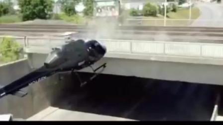 直升机想把宝马车吊起来,不巧的是却被宝马车拉了下来