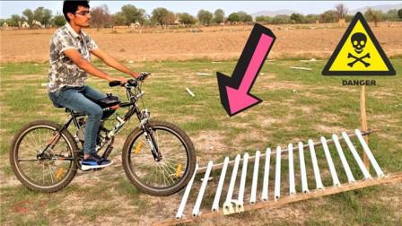 外国小伙胆子有多大?骑自行车挑战十几根灯管,现场太惨了