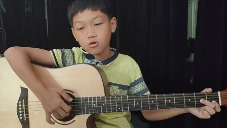 欧楚明同学学习《兰花草》吉他弹唱视频