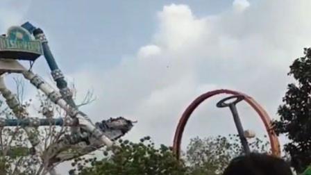 """触目惊心!印度一游乐园""""大摆锤""""突然断裂 31名游客被径直砸向地面"""