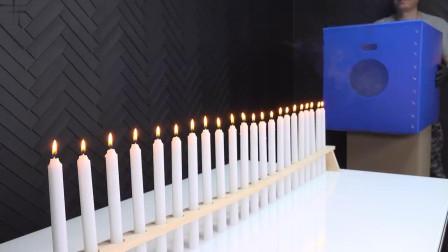 """22支蜡烛纵向排列,空气炮能一次将它们""""轰""""灭吗?"""