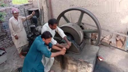 巴铁大叔们日常磨面,超大柴油机启动起来真费劲!