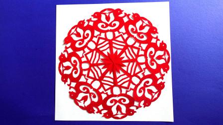 小兔图剪纸,按九角折纸方法将纸折好,设计图案,剪制完成作品