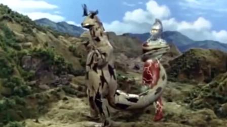 赛文被头部能发光线的怪兽缠住电击,只能发挥头镖的力量