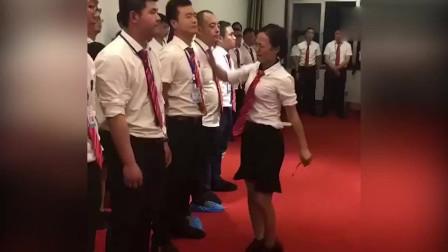 什么團隊?男員工站成一排 遭女同事輪流扇耳光