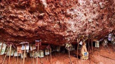 中国钱最多的山崖,崖洞中藏有上千万的纸币,为何却无人敢拿?