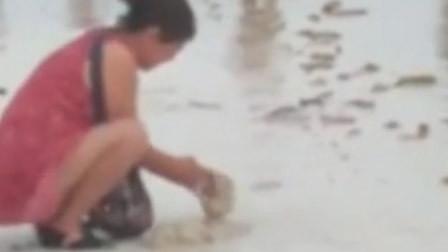 疑中国游客长滩岛沙滩埋尿片 致沙滩关闭3天寻找尿片