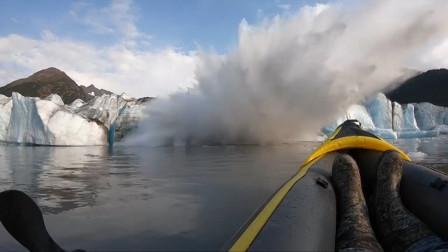 冰川突然崩塌掀起巨浪,划船者死里逃生