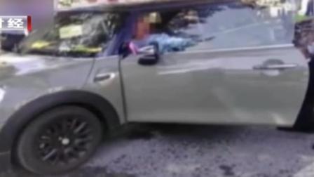 一女司机违停并击打民警  阻碍执法被刑拘 首都经济报道 20190824