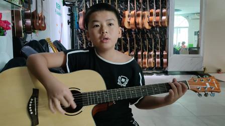何明洋同学学习吉他视频《童年》