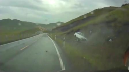 灵异事件:轿车连滚5圈翻上半坡,车子都成了废铁,司机毫发无损!