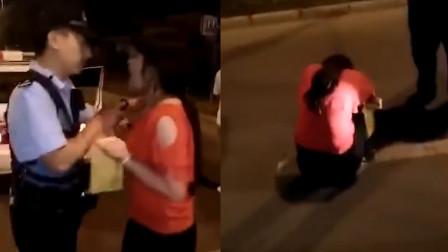女司机被查飙英文狂怼交警 被喷辣椒水后掩面哭泣