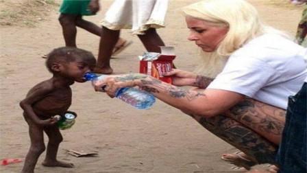 当年那个非洲讨水男孩,如今生活过得怎么样了?看完后令人落泪