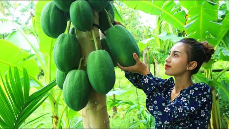 越南李子柒,村头的木瓜树挂满了木瓜,摘两个回来煮鱼汤