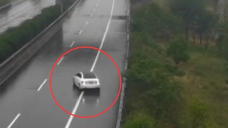 高速路上错过匝道 女司机蛇形倒车长达6分钟
