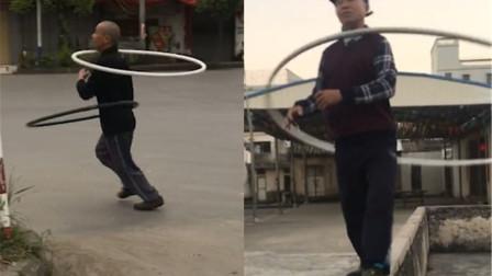 大叔用脖子转直径5米铁圈走红 网友:高手在民间