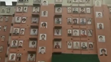 外墙挂上百副笑脸图 有人点赞有人吐槽 每日新闻报 20191013 高清版
