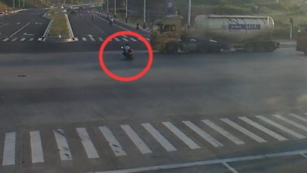 不幸中的万幸!男骑手闯红灯车轮下捡回一条命