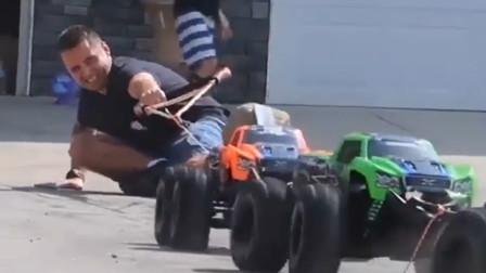 小哥和5辆遥控汽车比赛拔河,100多斤的人被车拖着走,爆发力真牛