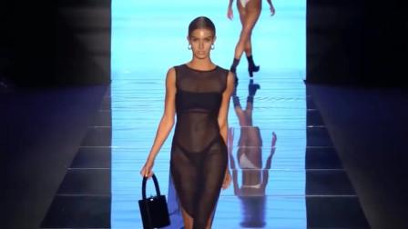 黑色网纱长裙,高开衩的设计,令人心动不已