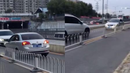 罚!北京轿车逆行被顶退百米 交警给出处罚结果
