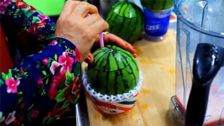 韩国街头的特色西瓜汁,老板这杯子让人眼前一亮,卖相太诱人了!