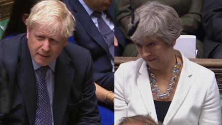 议员称新脱欧协议比前首相的更差 特雷莎·梅和约翰逊的表情亮了