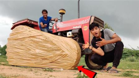 外国小伙大胆挑战:拖拉机缠满胶带,一脚油门下去画面太震撼了