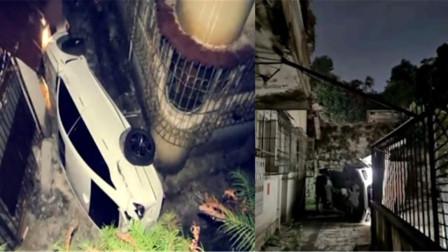 女司机倒车撞断围栏坠下4米高台:听到有人叫我